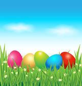 Yeşil çimenlerin üzerinde renkli Paskalya yortusu yumurta — Stok Vektör