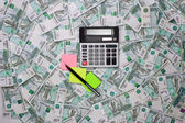 Calculators and colored stickers on a background of money — Foto Stock