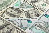 Background of Russian rubles and US dollars — Stock Photo