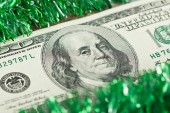 US hundred dollar bill with a Christmas tinsel — Stock Photo