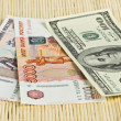 Постер, плакат: Russian rubles and US dollars on background napkins
