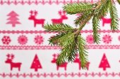 Spruce branch  on a background of a Christmas ornament — Stock fotografie
