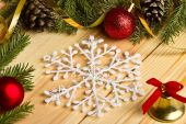 The spruce branches, Christmas balls and snowflakes on a wooden — Stock Photo