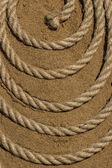The rope on the sea sand — Stock Photo