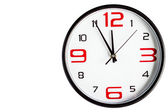 Black wall clock on a white background — Stock Photo