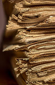 Pile of old newspapers on the shelf — Stock Photo