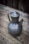 Old metal pitcher — Stock Photo