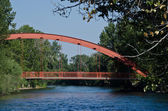 Red Bridge Extending Over the River — Stock Photo