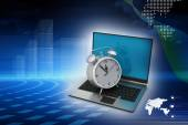 Alarm clock on laptop — Stock Photo
