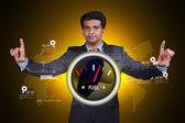 Businessman shows speedometer icon — Stock Photo