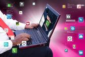 Businessman using computer interface — Stock Photo