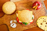 Delicious burger with fruits and vegetables — Stock Photo