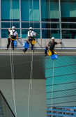 Team Of Climbing Workers On Office Building — Stock Photo