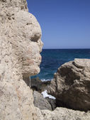 Face sculpted on a rock — Stock Photo