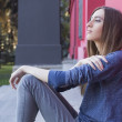 Brunette woman posing outdoors near red building. urban city. da — Stock Photo #56922447