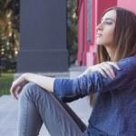 Brunette woman posing outdoors near red building. urban city. da — Stock Photo #56922447