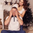 Loving couple celebrating christmas and new year at home sitting — Stock fotografie #57479169