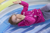 Little girl kid playing, having fun. outdoors — Stock Photo