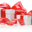 Two white boxes tied red ribbon bow isolated on the white backgr — Stock Photo #57315103