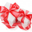 Two white boxes tied red ribbon bow isolated on the white backgr — Stock Photo #57315105