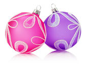 Pink and purple Christmas balls isolated on the white background — Stock Photo