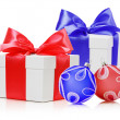 Two white boxs tied red and blue ribbon bow and christmas balls  — Stock Photo #58224623