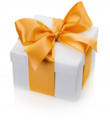 Gift box with yellow bow isolated on the white background — Photo