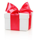 Gifting box with red bow isolated on the white background — Stok fotoğraf
