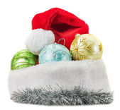 Christmas balls with Santa Clause hat isolated on the white back — Stock Photo