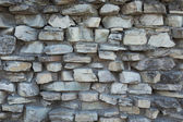 Old stone wall like a background — Stock Photo