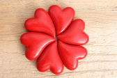 Hearts flower on wooden background — Stock Photo