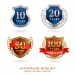 Anniversary golden heraldic labels set — Stock Vector #69395389