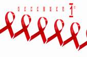 AIDS awareness red ribbon on white background. — Stock Photo