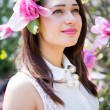 Dreamy girl with magnolia flower in her hair — Stock Photo #76879697