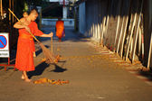 The monk was sweep street  — Stock Photo