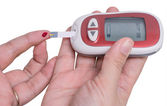 Hand testing for high blood sugar — Stock Photo