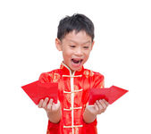 Boy with Chinese traditional dress holding ang pow — Stock Photo
