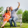 Pregnant Wife and Husband Taking Cell Phone Picture — Stock Photo #61232087