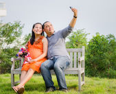 Pregnant Wife and Husband Taking Cell Phone Picture — Stock Photo