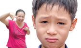 Young Asian crying while mother scold him — Stock Photo