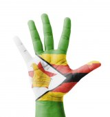 Open hand raised, multi purpose concept, Zimbabwe flag painted - — Stock Photo
