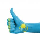 Hand with thumb up, Kazakhstan flag painted as symbol of excelle — Stock Photo