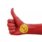 Hand with thumb up, Kyrgyzstan flag painted as symbol of excelle — Stock Photo