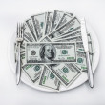 One hundred dollar bills lie on plate — Stock Photo #61497213