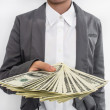 Businessman Displaying Spread of Cash — Stock Photo #61580609