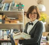 Asian woman holding books — Stock Photo