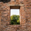 Brick wall with a window — Stock Photo #69968743