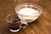 Coffee and bowl with brown sugar — Stock Photo