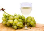 White wine with grapes — Stock Photo