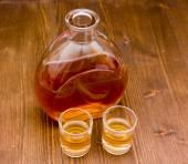 Bottle of whiskey on wood — Stock Photo